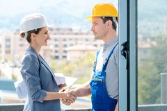 Handshake on construction site between developer and builder royalty free stock photography