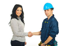 Handshake constructor worker and client. Happy constructor worker man and client woman giving handshake isolated on white background Stock Images