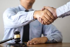 Handshake after consultation between a male lawyer and client, g. Iving advice and prosecutions about the regarding real estate stock photography
