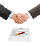 Handshake and contract Royalty Free Stock Images