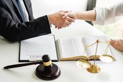 Handshake after cooperation between attorneys lawyer and clients discussing a contract agreement hope of victory over legal. Fighters, Concepts of law, advice royalty free stock photography
