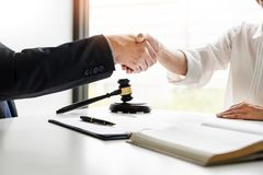Handshake after cooperation between attorneys lawyer and clients discussing a contract agreement hope of victory over legal. Fighters, Concepts of law, advice royalty free stock image