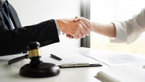Handshake after cooperation between attorneys lawyer and clients discussing a contract agreement hope of victory over legal. Fighters, Concepts of law, advice royalty free stock images