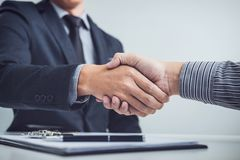 Handshake of cooperation customer and salesman after agreement,. Successful car loan contract buying or selling new vehicle stock image