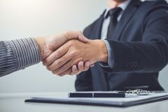 Handshake of cooperation customer and salesman after agreement,. Successful car loan contract buying or selling new vehicle stock images