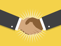Handshake and cooperation. Two hands make a handshake on a yellow background and fancy the beginning of cooperation and partnerships Royalty Free Stock Images