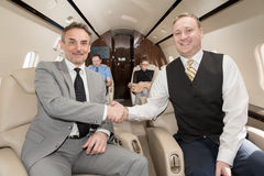 Handshake in corporate private jet Royalty Free Stock Photos