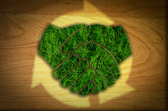 Handshake cut multiple use, Reduce, Recycle. Concept on green grass stock illustration