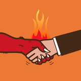 Handshake with the devil Stock Image
