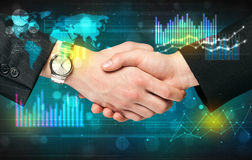 Handshake with diagrams Royalty Free Stock Photo