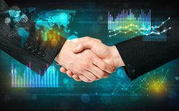 Handshake with diagrams Royalty Free Stock Photos