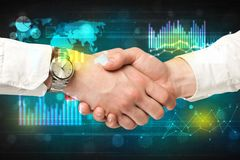 Handshake with diagrams Stock Image