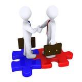 Handshake between different team leaders. Handshake between two 3d businessmen standing on puzzle pieces Stock Image