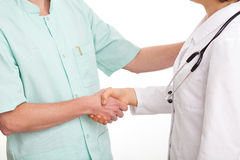 Handshake doctor and nurse Royalty Free Stock Photo