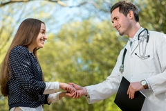 Handshake of a doctor and patient Stock Images