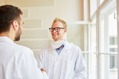 Handshake between doctor and physician. As successful teamwork and cooperation royalty free stock images