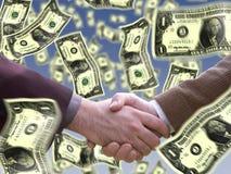 Handshake with dollar around Royalty Free Stock Images