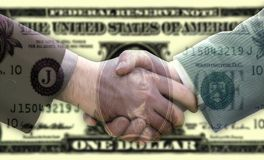 Handshake on dollar background Stock Image