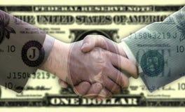 Handshake on dollar background stock image