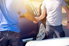 Handshake between drivers after a crash stock photography