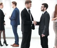 Handshake of the employees in the lobby of the office. Royalty Free Stock Photos