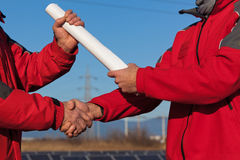Handshake between Engineers Stock Photography