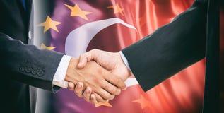 Handshake on EU - Turkey flags background Royalty Free Stock Photography