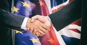 Handshake on EU - UK  flags background Royalty Free Stock Photos