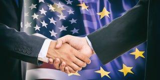 Handshake on EU - USA flags background Stock Images