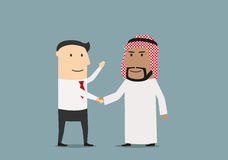 Handshake of european and arab businessmen Stock Photography