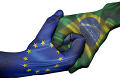 Handshake between European Union and Brazil Royalty Free Stock Image