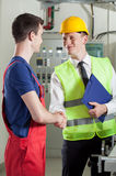 Handshake in a factory Royalty Free Stock Images