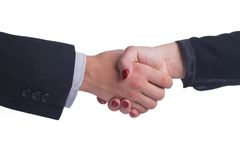 Handshake between female and male hand in a business style Stock Photos