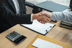 Handshake after finishing conversation Businessman sending a resignation letter to employer boss in order to resign dismiss. Contract, changing and resigning stock photo