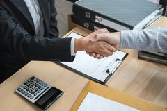 Handshake after finishing conversation Businessman sending a resignation letter to employer boss in order to resign dismiss. Contract, changing and resigning royalty free stock photo