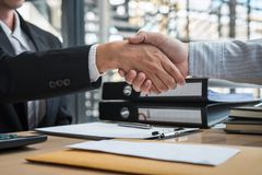 Handshake after finishing conversation Businessman sending a resignation letter to employer boss in order to resign dismiss. Contract, changing and resigning stock images