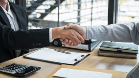 Handshake after finishing conversation Businessman sending a resignation letter to employer boss in order to resign dismiss. Contract, changing and resigning royalty free stock photography