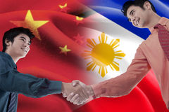 Handshake with flag of China and Philippines Stock Photo