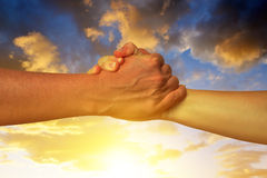 Handshake of friendship Stock Images