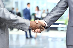 Handshake in front of business people Royalty Free Stock Image