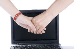 Handshake in front on laptop Stock Photography