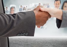 Handshake in front of sky with business people. Digital composite of Handshake in front of sky with business people Stock Image