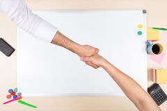 Handshake in front of a whiteboard Stock Images