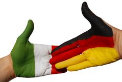 Handshake between german and italien flag. A handshake between the german and the italien flag, both painted on a hand Stock Photos