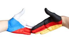 Handshake between germany and czech republic Stock Photos