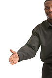 Handshake gesture from Black Businessman Stock Image