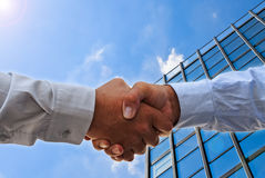 Handshake on glass building Royalty Free Stock Photos