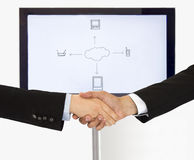 Handshake for global communication Royalty Free Stock Image