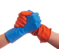Handshake in the gloves. Handshake in the colorful latex gloves Stock Photography
