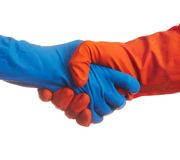 Handshake in the gloves. Handshake in the colorful latex gloves Stock Images